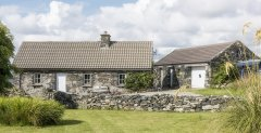 Maumeen Cottage, a traditional stone cottage, built in 1842, located on the shore of Maumeen Lake, Connemara, Co. Galway